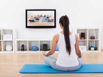 Spiritual woman meditating at home Royalty Free Stock Photos