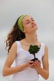 Spiritual woman planting a flower royalty free stock image