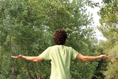 A Spiritual Young Man Worships. A youth looks to the heavens for guidance royalty free stock photo