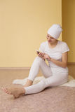 Spiritual young woman with a phone after yoga Royalty Free Stock Image