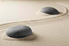 Spiritual zen meditation stones in sand Royalty Free Stock Photo