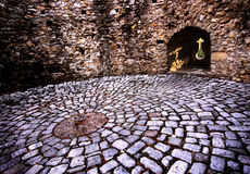 Spirituality. Hungarian round-bastion with cross-shaped loop-hole Royalty Free Stock Photos