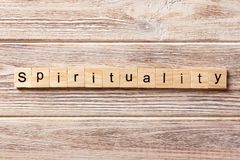 Spirituality word written on wood block. Spirituality text on table, concept.  Stock Photography