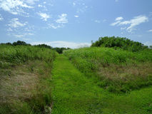 Spiro Mounds Archaeological Center mound with mowed walking trail Royalty Free Stock Image