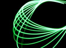 Laser Spirograph in green light expanded in a loop shape. A spirograph made with a green led light in a loop shape royalty free stock photo