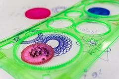 Spirograph toy. On paper reduction royalty free stock photos