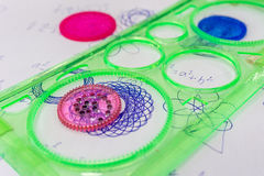 Spirograph toy. On paper reduction royalty free stock images