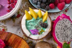 Spirulina algae bowl smoothie with mango. Pitahaya dragon fruit Royalty Free Stock Photos