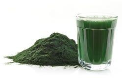 Spirulina algae powder. Stack of spirulina algae powder and spirulina drink isolated on white background Stock Images