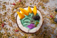 Spirulina bowl smoothie in coconut blackberry mango. And chia seeds Stock Photography