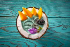 Spirulina bowl smoothie in coconut blackberry mango. And chia seeds Stock Image
