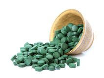Spirulina. In a bowl on a white background Stock Images