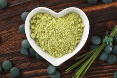 Spirulina, chlorella, gerst en wheatgrass Stock Afbeelding
