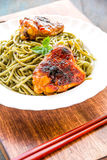 Spirulina Noodles with Chicken. Vertical close-up image royalty free stock images