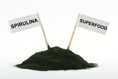 Spirulina powder algae isolated on white background Stock Images