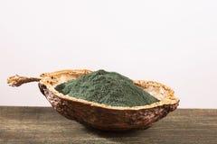 Spirulina powder dietary supplement - white background. Spirulina powder dietary supplement - Text space royalty free stock image