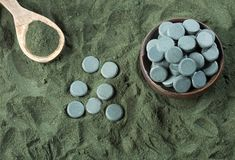 Spirulina powder and pills - Spirulina royalty free stock photo