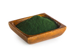 Spirulina powder. In wooden bowl isolated on white background. Superfood Royalty Free Stock Photography