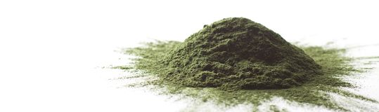Spirulina raw powder on white background – heap. Spirulina raw powder on white background, heap Royalty Free Stock Image