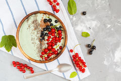 Spirulina smoothie bowl with berries and chia.