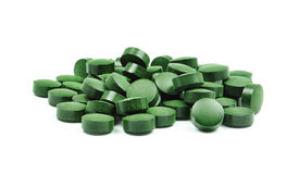 Spirulina. Tablets isolated on white background Royalty Free Stock Image