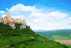 Spis castle on the cliff. Panorama on the North of Slovak republic stock photo