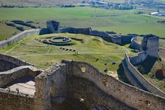 Spis Castle lower fortifications Spišský hrad Exterior view. The ruins of Spiš Castle lower castle and powder tower in eastern Slovakia form one of the stock photos