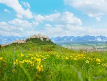 Spis castle with mountains on background. Spis Castle on the hill on the North of Slovak republic and Tatra mountains on background stock image