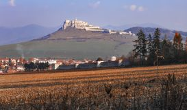 The ruins of Spis Castle in autumn - Slovak Republic. Spis Castle and rhe ancient wall of Spis Chapter house on the forehead, Slovak Republic stock images