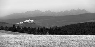 Spis castle, Slovakia. Ancient Spis castle with High Tatras mountains in background, black and white picture, Slovakia royalty free stock image