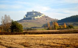 Spis Castle Spišský hrad Exterior view from across the golden fields stock photography