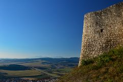 Spis Castle Spišský hrad view over to the high tatras. The ruins of Spiš Castle in eastern Slovakia form one of the largest castle sites in Central royalty free stock images