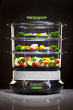 spis som lagar mat sunda ångagrönsaker Royaltyfri Bild