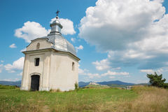Spisska Kapitula - Chapel over the st. Martins cathedral and riuns of Spissky castle Stock Image