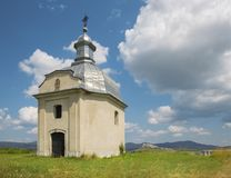 Spisska Kapitula - Chapel over the st. Martins cathedral and riuns of Spissky castle in the backgound. Slovakia, Spisska Kapitula - Chapel over the st. Martins stock image
