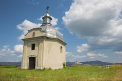 Spisska Kapitula - Chapel over the st. Martins cathedral and riuns of Spissky castle in the backgound.  royalty free stock photos
