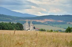 Spisska Kapitula, Slovakia. St. Martin's Cathedral with rural landscape in the background in Spisska Kapitula, Slovakia royalty free stock photo