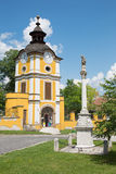 Spisska Kapitula - St. John the Nepomuk column anb clock tower. Stock Images