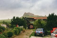 Spisske Podhradie town and Spis Castle Spissky hrad , Presov Region, Slovakia June 17, 2016 View from the hotel to the castle in c. Loudy summer weather royalty free stock photos