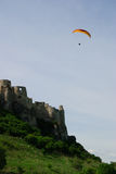 Spissky hrad. Paraglider flying over the medieval castle Spisz Stock Images