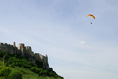 Spissky hrad. Paraglider flying over the medieval castle Spisz Royalty Free Stock Image