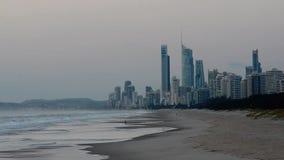 Spit Beach with Surfers Paradise CBD skyline at dusk Gold Coast Australia stock video