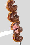 Spit roast sirloin. In white background Stock Photo