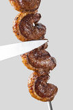 Spit roast sirloin. In white background Royalty Free Stock Photos