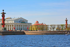 Spit of Vasilevsky Island and Rostral columns in St. Petersburg, Russia. View of Spit of Vasilevsky Island, Pushkin house and Rostral columns in St. Petersburg Royalty Free Stock Photo