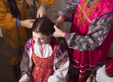 Spit women braid Russian tradition. Girl braids plait Russian tradition Royalty Free Stock Image