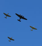 Spitfire aircraft flying in formation over Southern England with a single Bristol Blenheim bomber. Royalty Free Stock Photography
