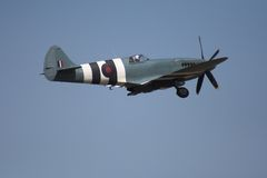 Spitfire in flight stock photography