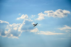 Spitfire in flight on blue cloudy sky Stock Image