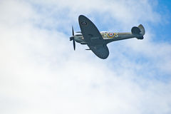 Spitfire flying into cloud. Royalty Free Stock Image